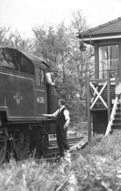 Peasmarsh Junction handing over the single line token - early 1960's